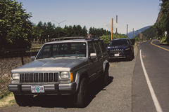 Portland, Oregon, USA - June 12, 2015: Old and New Jeep Cherokee parked on the road Royalty Free Stock Image