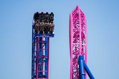 `Adrenaline peak` roller coaster ride. Portland, Oregon / USA - June 24 2018: People riding down the `Adrenaline peak` roller coaster ride in Oaks amusement park stock image