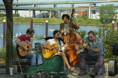 Musicians play string instruments in Tom McCall Park Royalty Free Stock Photography