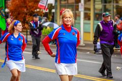 Veterans Day Parade 2017. Portland, Oregon, USA - November 11, 2017: The Beat Goes On Marching Band in the annual Ross Hollywood Chapel Veterans Day Parade, in royalty free stock image