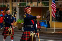 Veterans Day Parade 2017. Portland, Oregon, USA - November 11, 2017: Portland Police Highland Guard Pipe Band in the annual Ross Hollywood Chapel Veterans Day royalty free stock image