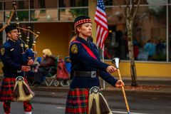 Veterans Day Parade 2017. Portland, Oregon, USA - November 11, 2017: Portland Police Highland Guard Pipe Band in the annual Ross Hollywood Chapel Veterans Day royalty free stock photos