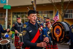 Veterans Day Parade 2017. Portland, Oregon, USA - November 11, 2017: Portland Police Highland Guard Pipe Band in the annual Ross Hollywood Chapel Veterans Day royalty free stock photo