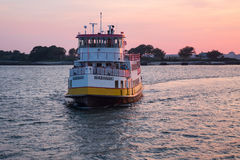 Portland - Peaks Island Ferry Boat at Sunset. The Wabanaki ferry boat returning from Portland Harbor to Peaks Island, Maine in a brilliant summer sunset Royalty Free Stock Image