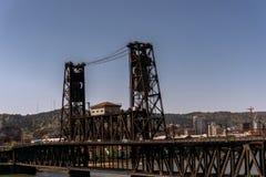 Portland's Steel Bridge. Portland Oregon steel bridge constructed in 1912 is a multi modal bridge carrying, trains, max train, pedestrian, and auto traffic on Stock Image