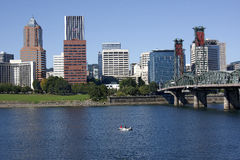 Portland Skyline and boat. The Portland Oregon skyline and a fisherman with his boat on the Willamette river Royalty Free Stock Photos