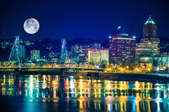 Portland Skyline with Moon. And the Willamette River. Downtown Portland, Oregon, United States Royalty Free Stock Photography