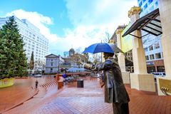 Allow Me, also known as Umbrella Man in Pioneer Courthouse Squar. Portland, United States - Dec 21, 2017 : Allow Me, also known as Umbrella Man, is an iconic Royalty Free Stock Image