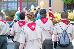 Boy scouts on the street royalty free stock images