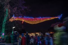 Oriental dragon made out of Christmas lights. Portland, OR / USA - December 21 2018: Oriental dragon made out of Christmas lights hanging at Portland zoo royalty free stock photo