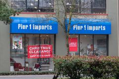 Pier1 Imports store front with Christmas clearance banner. Portland, OR / USA - December 10 2018: Pier1 imports store with big Christmas clearance sign in the stock images