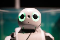 Cute robot with big green eyes royalty free stock photos
