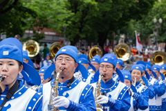 Asian marching band dressed in uniform. Portland, OR / USA - June 11 2016: Grand floral parade. Asian marching band dressed in uniform stock photography