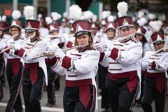 Marching band walking down the street playing flutes. Portland, OR / USA - June 11 2016: Grand floral parade - Marching band walking down the street playing royalty free stock photography