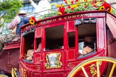 Red vintage carriage cart with `wells fargo & company` sign on it. royalty free stock images