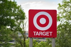 Huge Target store sign. Portland, OR / USA - June 20 2018: Huge target retail store sign surrounded by green trees royalty free stock photo