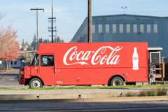 Coca cola delivery van parked at the curb stock image