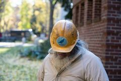 Old guy in the Bernie Sanders hard hat. stock images