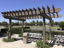 Portland Wooden Pergola. Aluminum dining table under light shading pergola, Camarillo outdoor, Ventura county, Southern California Royalty Free Stock Image