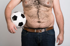 Portly belly of a man football Stock Image