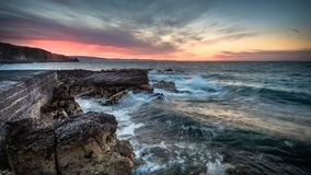 Portmuck, Islandmagee, County Antrim, Northern Ireland: Beyond the Harbour Wall. Portmuck, Islandmagee, County Antrim, Northern Ireland: A sunset scene from the stock photo
