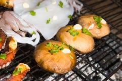 Mushrooms and sea food on barbecue, Greece. Stock Photo