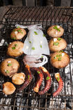 Mushrooms and sea food on barbecue, Greece. Royalty Free Stock Image