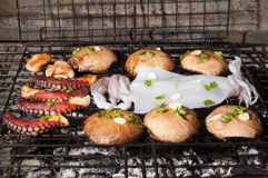 Mushrooms and sea food on barbecue, Greece. Royalty Free Stock Photos