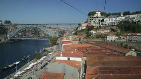 Porto Cable car POV. Porto, Portugal - August 13, 2017: Aerial view POV hyperlapse of Dom Luis I Bridge on Douro River, Monastery of Serra do Pilar and Riberira stock video footage