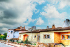 Porto Cervo buildings under a dramatic sky in hdr Stock Photo