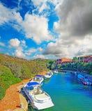 Porto Cervo canal under a cloudy sky Royalty Free Stock Image