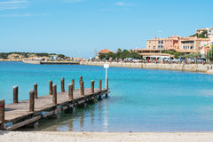 Porto Cervo pier. Porto Cervo wooden pier and turquoise sea Stock Images