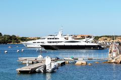 Porto Cervo, Sardinia, Italy - A luxury yacht in the porto cervo harbor. Luxury yachts in the porto cervo harbor. Porto Cervo is an Italian seaside resort in royalty free stock images