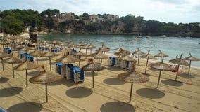 Straw umbrellas on the beach in Porto Cristo on Mallorca, Spain. PORTO CHRISTO, MAYORKA - SEPTEMBER 6, 2017: Straw umbrellas on the beach on Mallorca, Balearic stock video