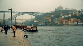 Porto, circa 2018: Embankment of the Douro River on a cloudy day. Porto, circa 2018: Embankment of the Douro River on a cloudy day stock video