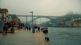Porto, circa 2018: Embankment of the Douro River on a cloudy day. Porto, circa 2018: Embankment of the Douro River on a cloudy day stock footage