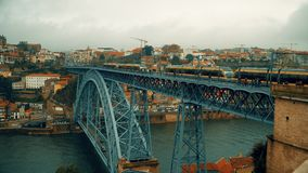 Porto, circa 2018: Panoramic view of the old city of Porto. Portugal. The Metro Train crosses the Dom Luis 1 Bridge over. Porto, circa 2018: Panoramic view of stock video