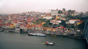 Porto, circa 2018: Panoramic view of the old city of Porto. Portugal. The Metro Train crosses the Dom Luis 1 Bridge over. Porto, circa 2018: Panoramic view of stock video footage