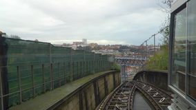 Porto, circa 2018: Timelapse Rising on the funicular Guindais Funicular, Porto. Panoramic view of the old city of Porto. Portugal. The Metro Train crosses the stock video