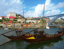 Porto city, Portugal. Wine boats in Porto city, Portugal. In the background the Don Luis Bridge, build in Gustave Eiffel style stock photo