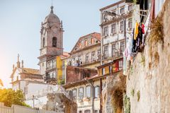 Porto city in Portugal. Street view on the beautiful old buildings and church tower in Porto city, Portugal Royalty Free Stock Photos
