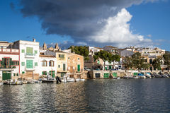 Porto Colom harbour with boat shelters Royalty Free Stock Photography