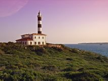 Porto Colom Lighthouse. In the southeast of Majorca (Balearic Islands - Spain) at dusk Royalty Free Stock Photo