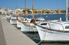 PORTO COLOM, MALLORCA,. PORTO COLOM in MALLORCA, BALEARIC ISLANDS, SPAIN, May 6, 2015. Mallorca, marina with boats, fishermen village in Porto Colom. Mallorca Royalty Free Stock Photography
