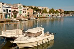 PORTO COLOM, MALLORCA,. PORTO COLOM in MALLORCA, BALEARIC ISLANDS, SPAIN, May 6, 2015. Mallorca, marina with boats, fishermen village in Porto Colom. Mallorca Stock Images