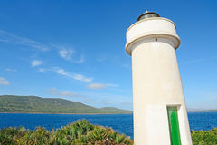Porto Conte lighthouse under a blue sky Royalty Free Stock Photo