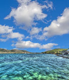 Porto Conte shore on a clear day Royalty Free Stock Photography