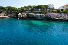 Porto Cristo bay and rocky shore, Majorca island Stock Image