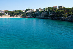 Porto Cristo bay and town beach, Majorca, Spain Stock Images
