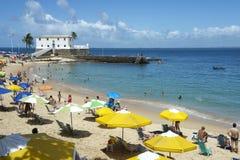 Porto da Barra Beach Salvador Bahia Brazil. Bright beach umbrellas decorate Porto da Barra beach in Salvador Bahia Brazil royalty free stock photography